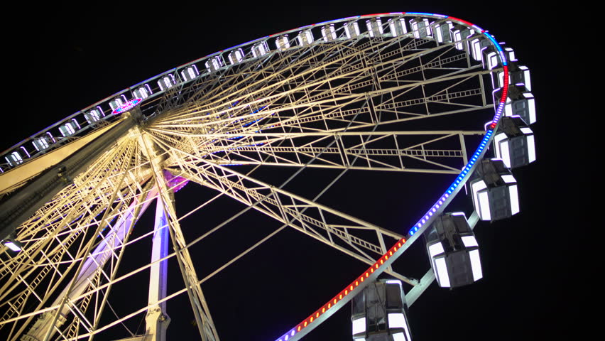 Huge observation wheel stops moving at night amusement park, entertainment | Shutterstock HD Video #16895272
