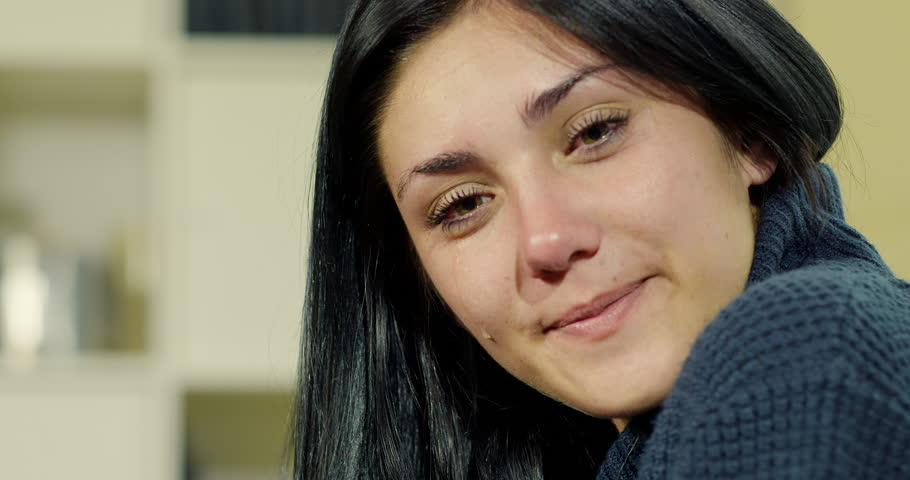 Beautiful woman crying for happiness 4K | Shutterstock HD Video #16900381