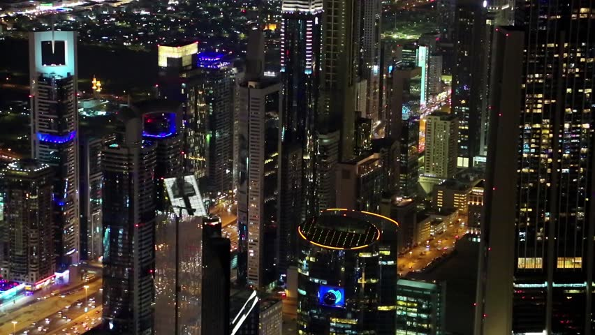 Dubai downtown at night, United Arab Emirates. View on Sheikh Zayed road from 124th floor of Burj Khalifa skyscraper in Dubai, currently tallest structure in the world, 829m. At the top - Burj Khalifa | Shutterstock HD Video #16921882