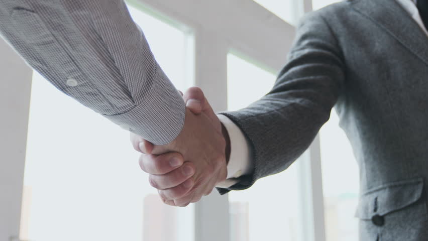 Business partners handshaking. Slow motion 100 fps