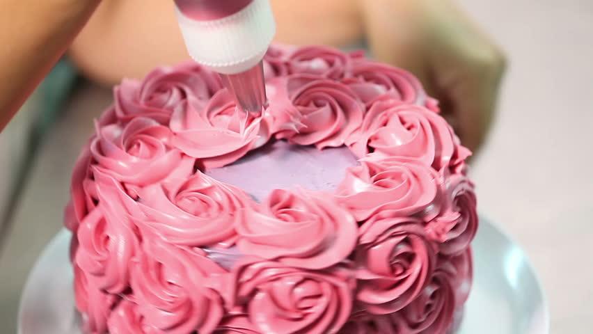 confectioner decorates cakes on Valentine day