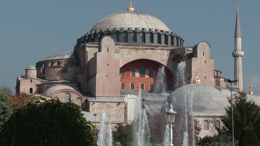 Tilt up from Sultan Ahmet Park with fountains to the Hagia Sophia on a sunny autumn day. Istanbul, Turkey | Shutterstock HD Video #16956742