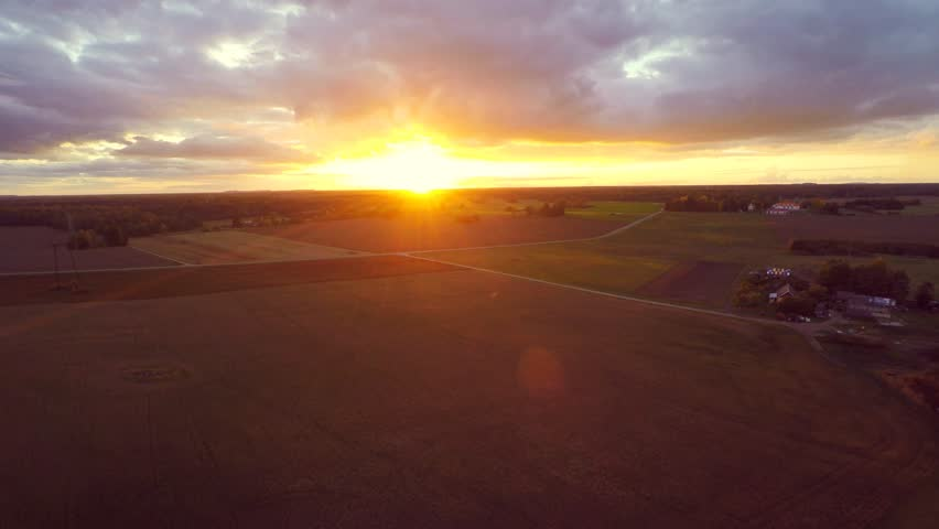 Beautiful sunset at field. Low altitude flight. Aerial footage. | Shutterstock HD Video #16957162