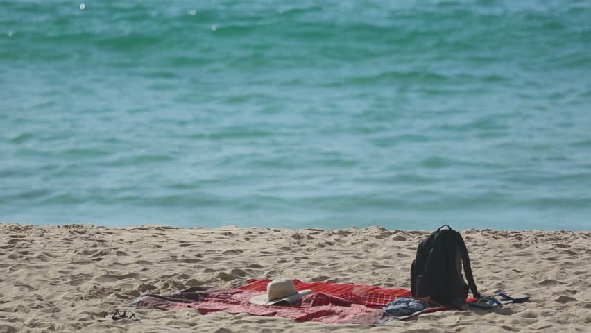 Travel Backpack On Summer Sea Beach. Holiday And Vacation Symbol   HD Stock  Video Clip
