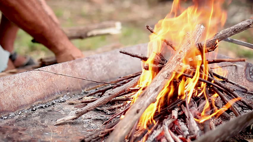 Entre Rios, Argentina - January 31, 2013: Building wood fire in fire pit
