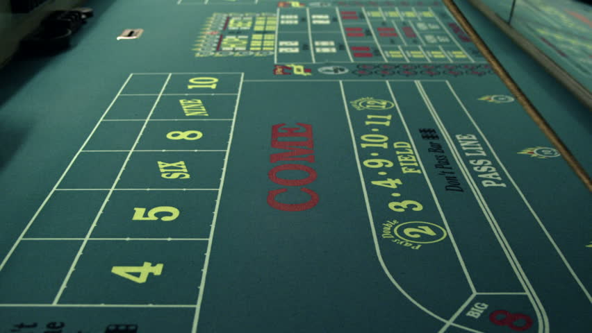 Moving dice across a craps table with the craps stick. | Shutterstock HD Video #1701802