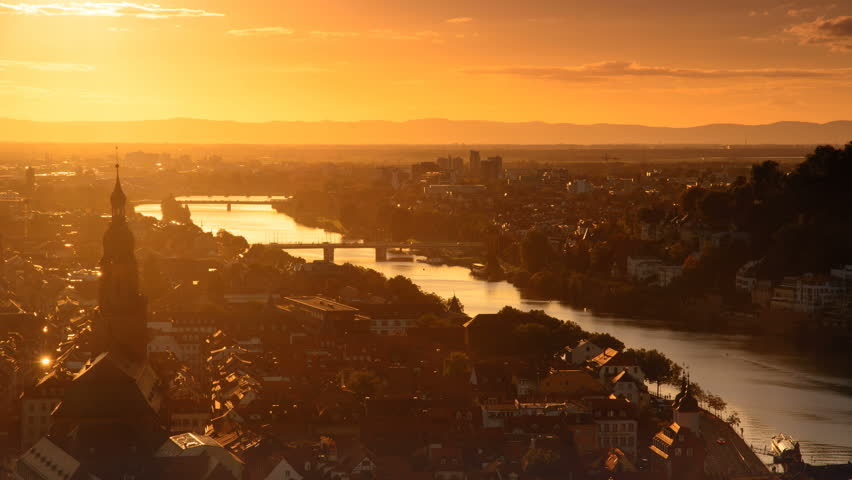 Heidelberg, Germany, timelapse video of the romantic aerial view at sunset and dusk, with the lights of the city and the Neckar river