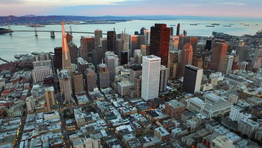 Aerial view of the financial district and the Bay Bridge of San Francisco, California. United States. Skyline. Shot from helicopter. #17054128