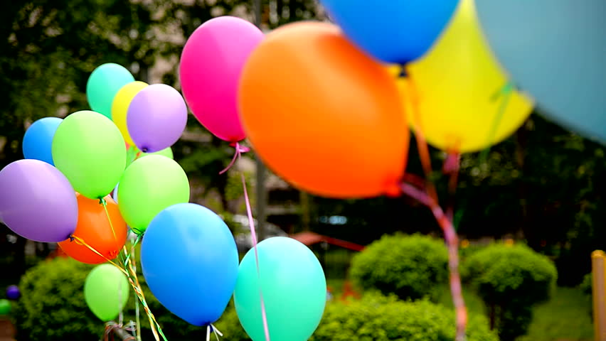 Festive colorful gel air balloons, associated bundles, swaying in the light wind blow. Festive accessories: balloons in the bundle.   Shutterstock HD Video #17056012