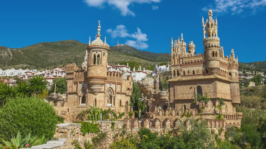 Castillo de Colomares in 4K with moving clouds. It is a monument similar to a fairytale castle, dedicated to Christopher Columbus. Benalmadena, near Malaga in Andalusia, Spain.