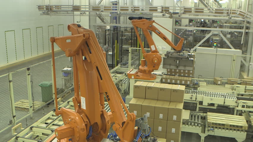 Packaging robots stow boxes on palletes.