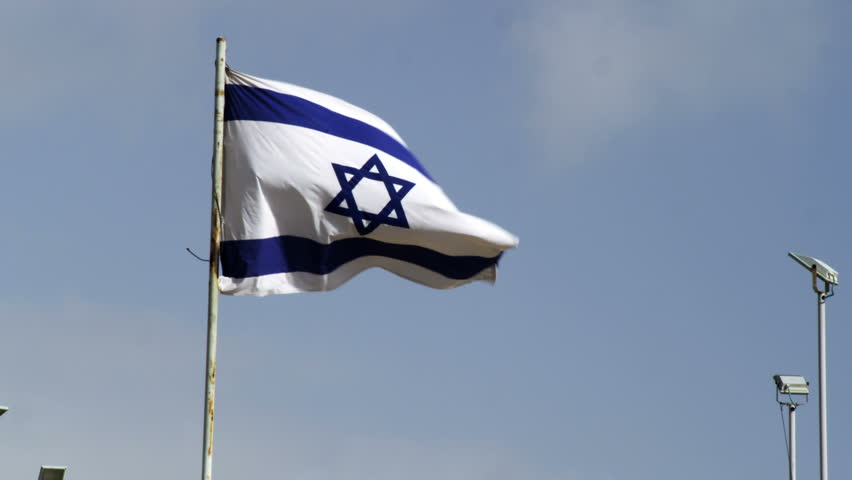 The israeli flag waving in the wind above the grounds at the the israeli flag waving in the wind above the grounds at the western wall wailing wall in jerusalem israel 02262011 stock footage video 1710832 sciox Image collections