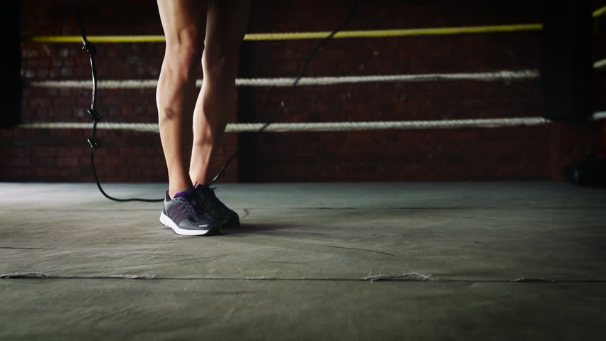 Young woman jumping rope double jumps in the gym stock footage video woman training gym skipping mma ring jump rope mixed martial arts fitness hd stock footage altavistaventures Choice Image