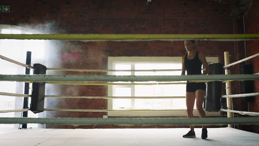 Woman training gym boxing mma ring shadow boxing mixed martial arts woman training gym skipping mma ring jump rope mixed martial arts fitness hd stock video altavistaventures Choice Image
