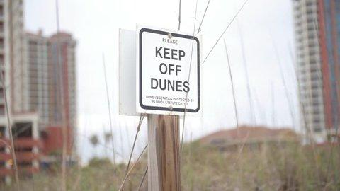 Keep of Dunes Sign in Pensacola Beach, Florida.