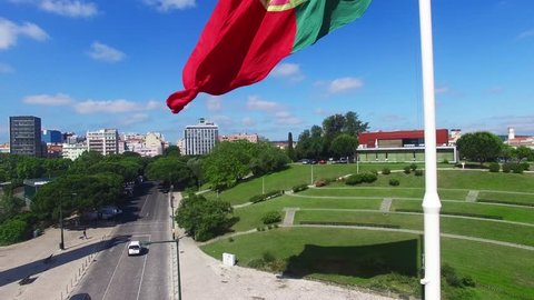 Portuguese Waving Flag in Eduardo VII Park in Lisbon, Portugal aerial view