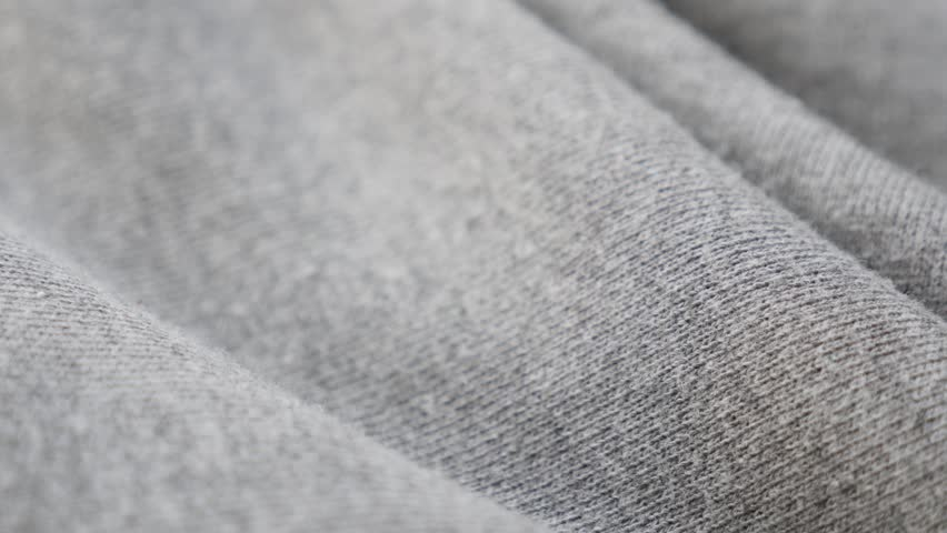 1bee737c Gray sweat shirt or pants fine fabric texture close-up 4K 2160p 30fps  UltraHD tilting footage - Cotton and polyester pattern of training cloth  slow tilt 4K ...