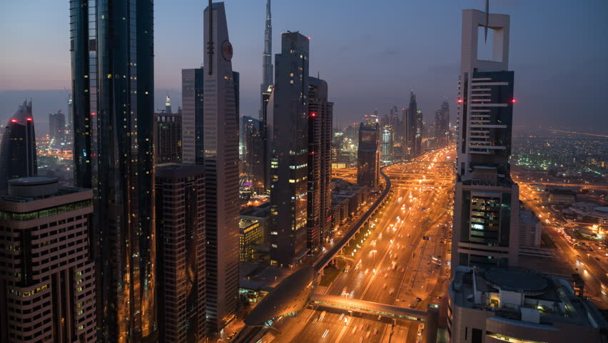 DUBAI, UNITED ARAB EMIRATES - FEBRUARY 2016: Time Lapse of view down skyscraper lined Sheikh Zayed Road at dusk, Dubai, United Arab Emirates | Shutterstock HD Video #17170342