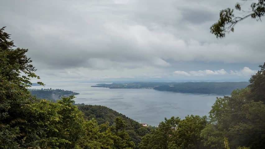 A big rain storm with low hanging storm clouds over Lake Constance in southern Germany, shot as a Time Lapse Sequence.