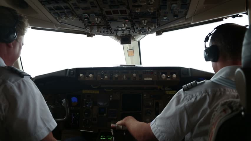KRABI, THAILAND, APRIL 20th, 2016. Two pilots in the cockpit of a passanger airplane from Bangkok to Krabi, Thailand, on April 25th, 2016.