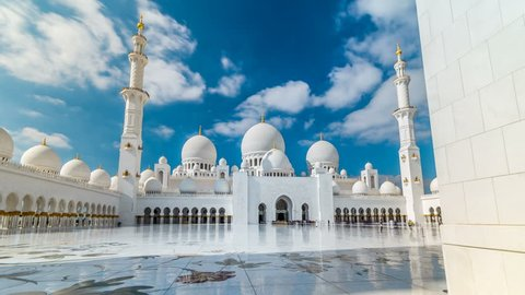 Sheikh Zayed Grand Mosque timelapse hyperlapse  located in Abu Dhabi. Mosque was initiated by late President of UAE Sheikh Zayed bin Sultan Al Nahyan. It is largest mosque in UAE. Blue cloudy sky