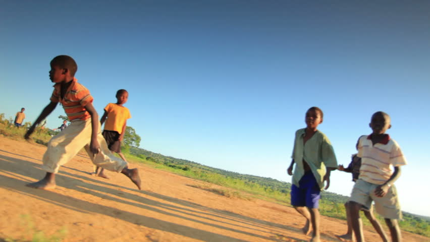 KENYA, AFRICA - CIRCA 2011:  Children playing soccer on the fields in Kenya, Africa.
