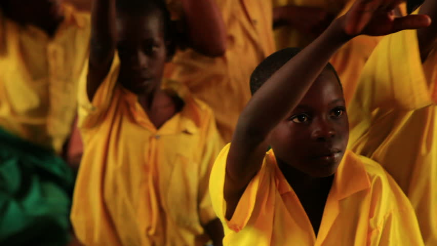 KENYA, AFRICA - CIRCA 2011: Close up of boy raising his hand in a full classroom in Kenya, Africa. Front view.