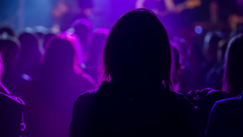 Some people are standing still at a concert and are not moving. The crowd in the first row is dancing and having fun. | Shutterstock HD Video #17313712