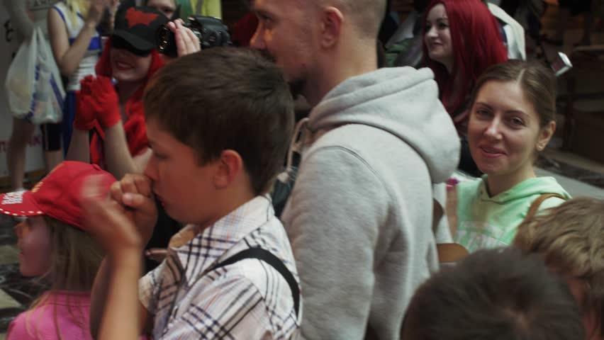 SAINT PETERSBURG, RUSSIA - JUNE 4, 2016: Happy people applaud in shopping center. Entertainment event. Teens. Cameraman. Cheering #17349682