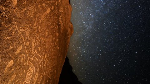 Astrophotography Time Lapse of star trails over Native American petroglyphs in Eastern Sierra, California -Vertical Shot-