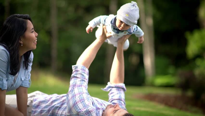 Mixed Race Young Palying WIth Their Son at Park | Shutterstock HD Video #17387230