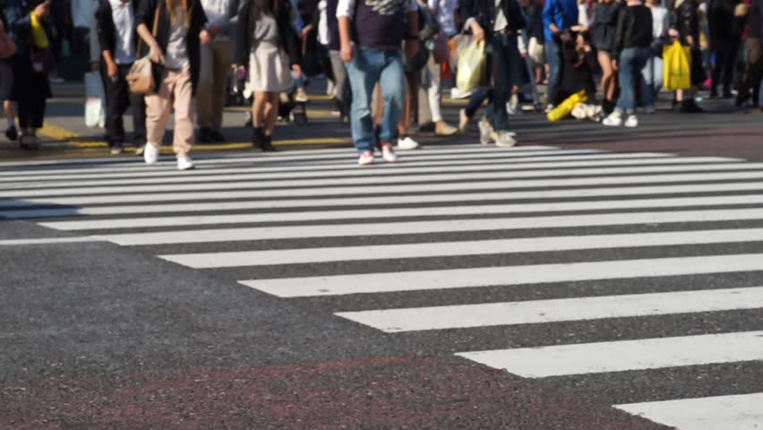 People Step Across A Road By Crosswalk Or Zebra Crossing ...