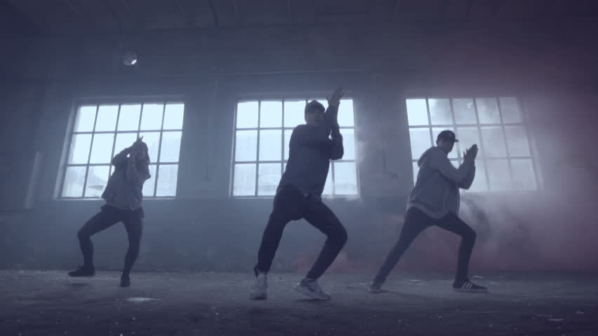 Video of active young group dancing choreography in an abandoned building with smoky background in slow motion. | Shutterstock HD Video #17395492