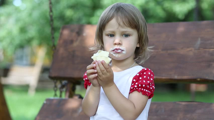 Beautiful Little Girl Eating Ice Cream Outdoor Stock Photo ...