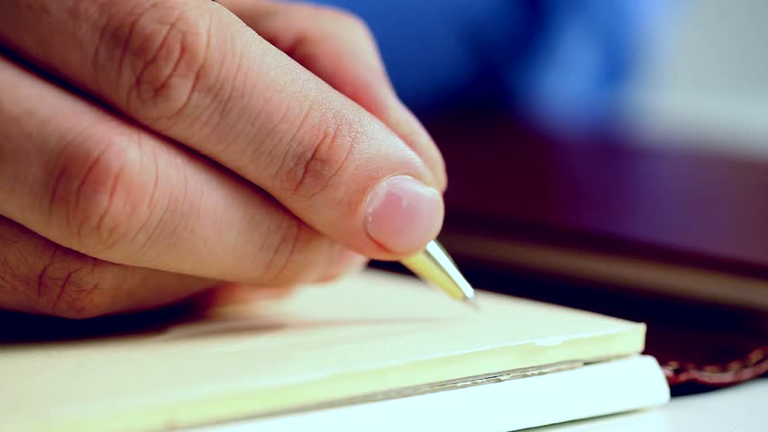 Man writing documents