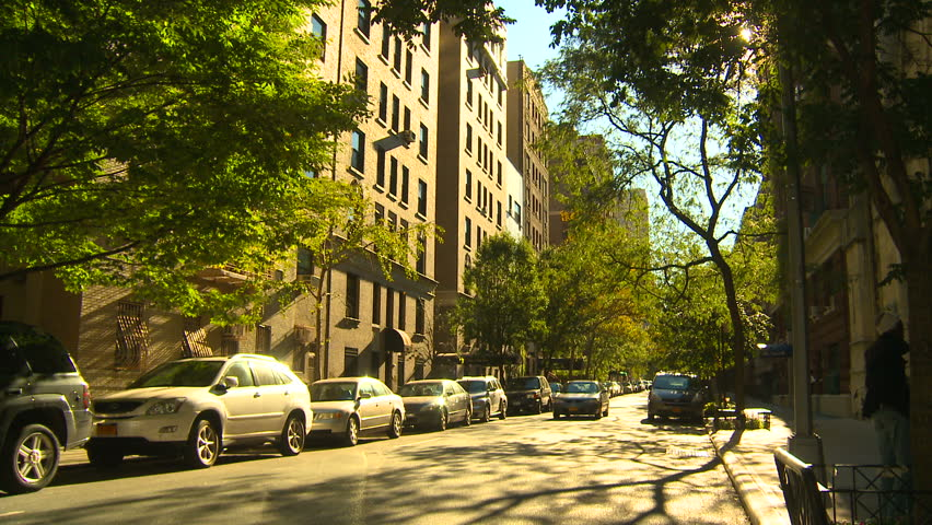 NEW YORK, NY - NOVEMBER 9, 2010: Cars drive down a quiet residential street on the Upper West Side
