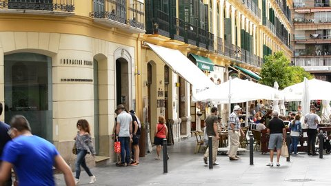 Facade of the founding of Picasso with people coming and walking, Málaga, Andalusia, Spain