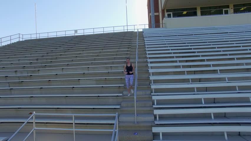 Aerial of woman running in sports stadium | Shutterstock HD Video #17479102