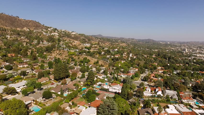 Glendale Aerial v6 Flying low over luxury neighborhood in the hills panning.