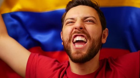 Colombian fan celebrates holding the flag of Colombia in Slow Motion