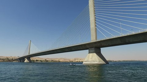 View of new Aswan bridge over Nile river from felucca boat