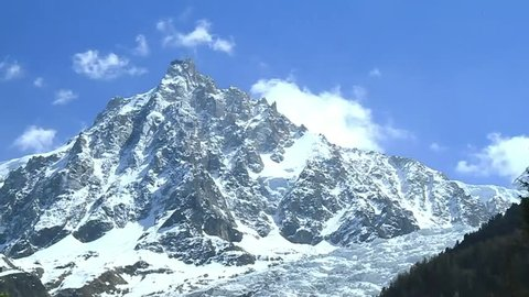 """Peak of Mont Blanc in Frenchâ??Italian border. The Alpine region area contains about a hundred peaks higher than 4,000 m (13,123 ft), known as the """"four-thousanders""""."""