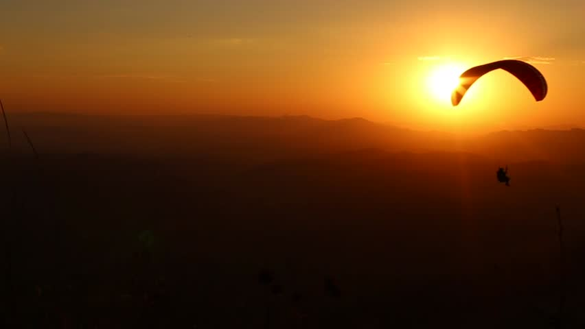 paragliding with beautiful sunset background