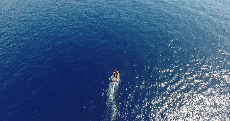 AERIAL: motorboat start in the blue sea | Shutterstock HD Video #17519452