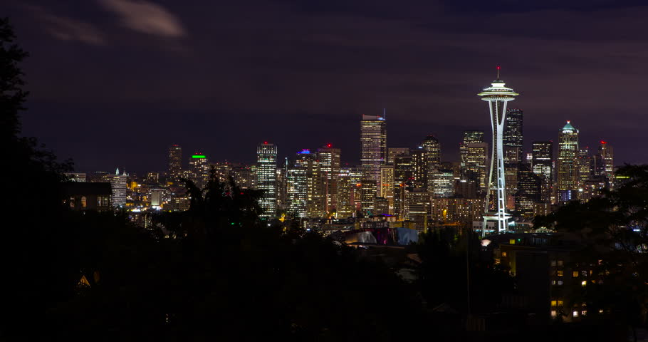 Seattle, Washington, USA - illuminated skyline of Seattle with Space needle as seen from Kerry Park at night with moving clouds - Timelapse with motion