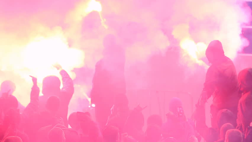 Hooligans using burning flares, smoke bombs at tribunes during football game | Shutterstock HD Video #17548369