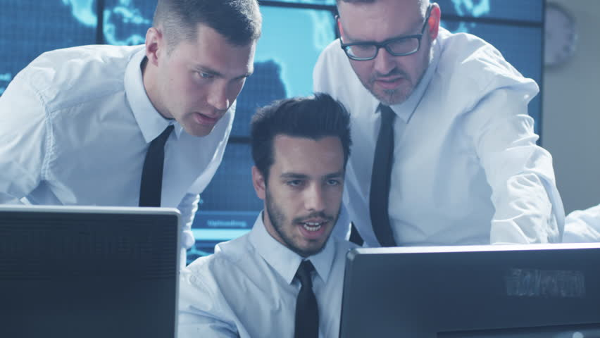 Team of IT Security Professionals Working in Monitoring Room. Shot on RED Cinema Camera in 4K (UHD). | Shutterstock HD Video #17553532
