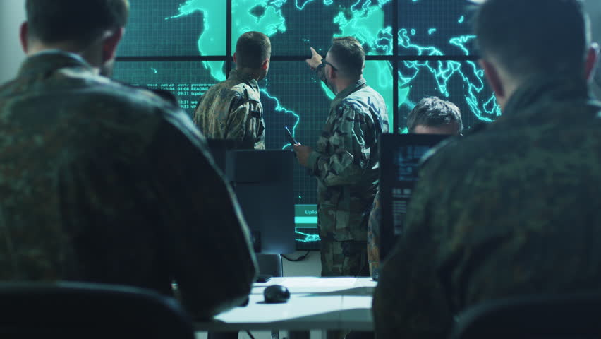 Group of Military IT Professionals on Briefing in Monitoring Room on Military Base. Shot on RED Cinema Camera in 4K (UHD). | Shutterstock HD Video #17573182