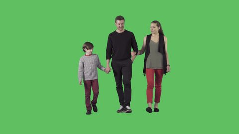 Young parents and son are slowly walking at the camera. Camera is static. Lens 85 mm. Footage with alpha channel. File format - .mov, codec PNG+Alpha
