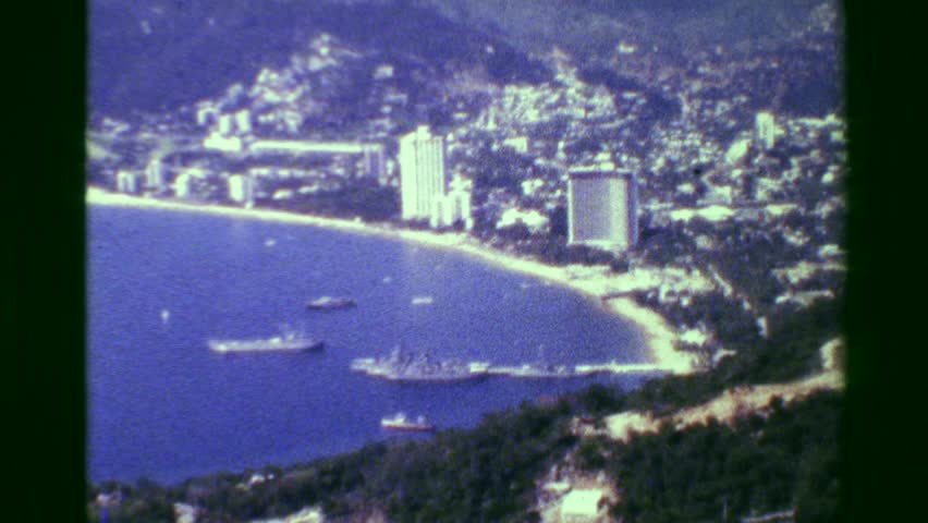 ACAPULCO, MEXICO 1978: Acapulco harbor bay hotel beach resort area high perspective view.